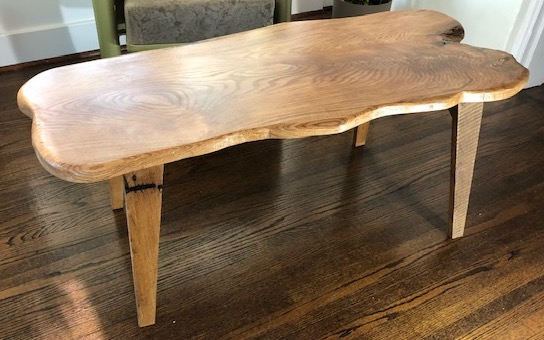 Red oak plank table has loads of character